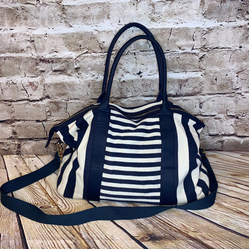 Merona nautical blue and white strip crossbody/tote hybrid in canvas.  Blue vinyl straps and navy interior lining with gold hardware.
