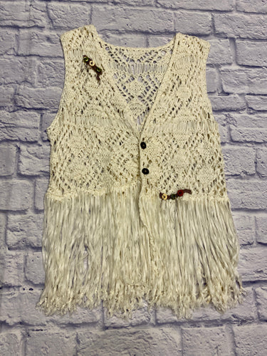 Upcycled crochet vest in cream with fringe bottom detail.  Multi-color buttons hand sewn on front shoulder and front hemline as well as lace and buttons on back.
