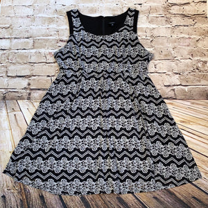 Torrid black and white casual dress with floral and chevron design.