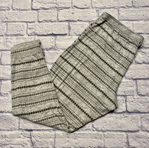 Light grey heathered sleep pants with darker grey geometric patterned stripes.  Elastic waistline and ribbed, cuffed leg hems.