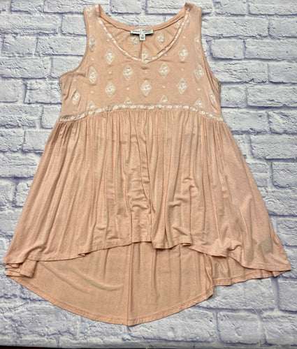 Torrid blush tank with romantic embroidery decorating the bodice of a soft and slinky babydoll tank.