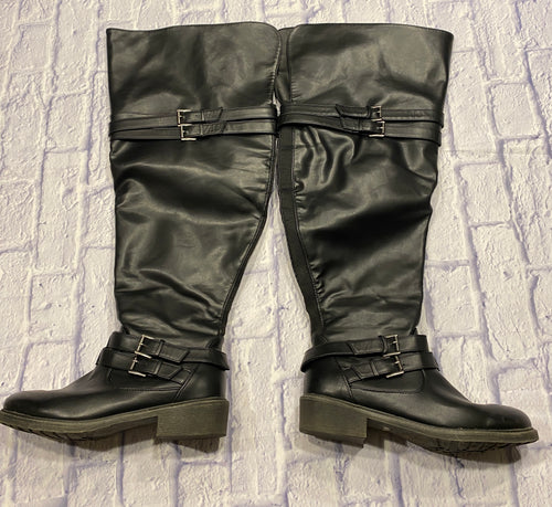 Torrid oiled faux suede over-the-knee boots features straps with adjustable buckles, and a comfortable block heel.  Wide calf.  Side goring and zipper.  Like new, in box.
