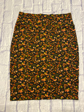 Load image into Gallery viewer, Lularoe black stretchy midi skirt with orange and green flowers.  Thick waistband.  Runs big.