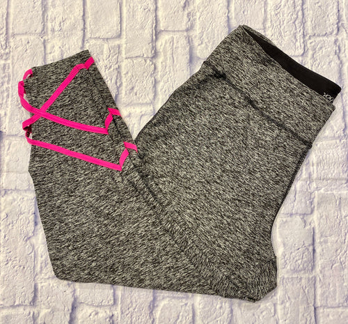 Vogo Athletica grey heathered active capri with hot pink strap detail at leg cuffs.
