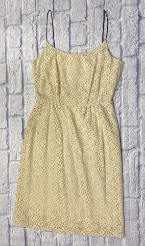 J Crew cream lace mini dress with black spaghetti straps and elastic waist.  Cream under lining.  Adorbs.