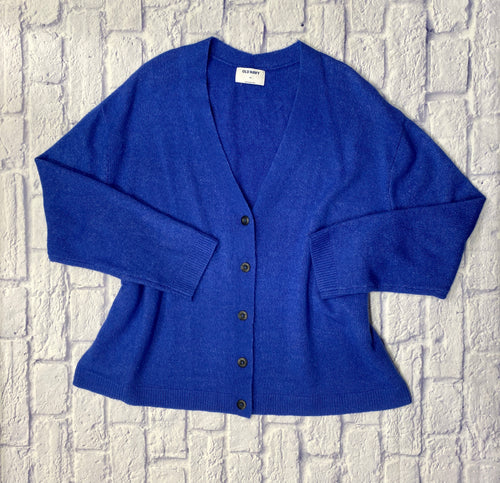 Old Navy royal blue grandpa cardigan with four black button closure.  Slight purple tint to the fabric weave.  Slightly oversized.