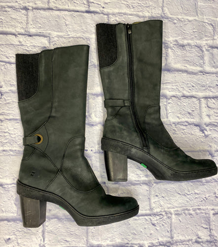 El Naturalista knee high boots in black leather with calf elastic and chunky heel.  Ankle strap detail.  Like new condition!
