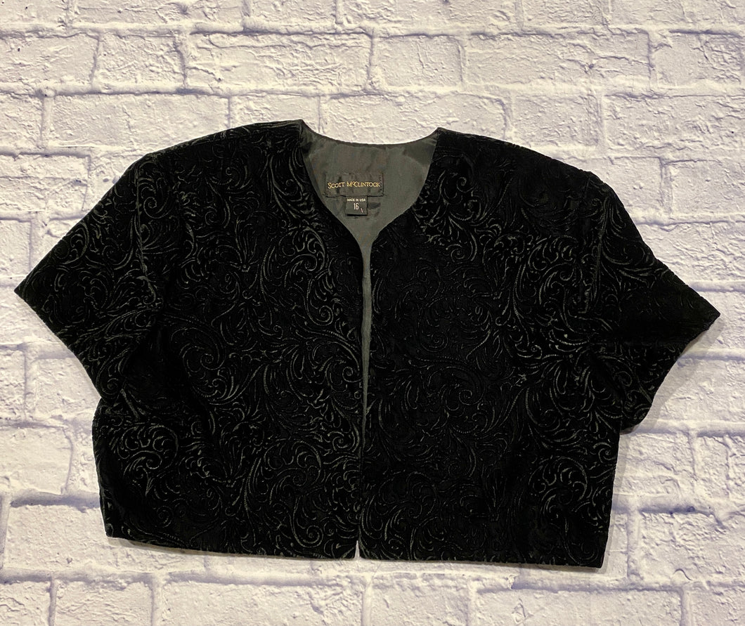 Scott McClintock black vintage velvet bolero with intricate pattern embossed.  Shoulder pads, cropped.  Perfect for that special occassion!