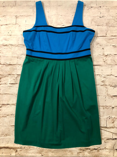 Eloquii blue and green color block party dress with black piping detail and satin lining.