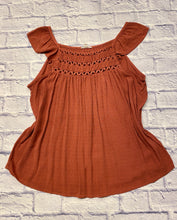 Load image into Gallery viewer, Maurices top in burnt orange with crochet detail along neckline and ruffle cap sleeve.  Dotted swiss fabric.
