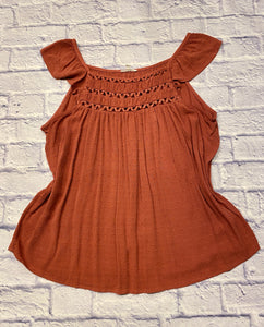 Maurices top in burnt orange with crochet detail along neckline and ruffle cap sleeve.  Dotted swiss fabric.