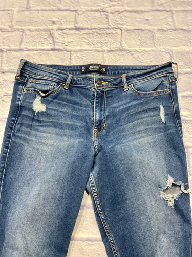 Hollister distressed medium wash skinny jeans.  Zip and button closure.  Holes on front thigh and below knee.  Slight back pocket pattern.  High Rise.