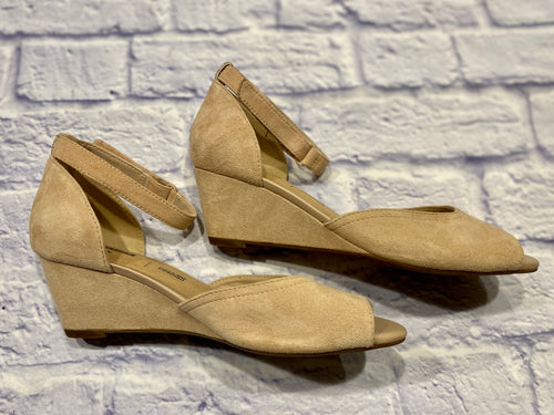 Clark's nude peep toe wedge sandals with velcro ankle straps in soft suede.  Low heel.