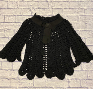 Franco Ziche black crochet capelet with scalloped hem and neck.  3/4 sleeves with scallop hem as well.  Black satin collar with snap closure.  Absolutely adorable!