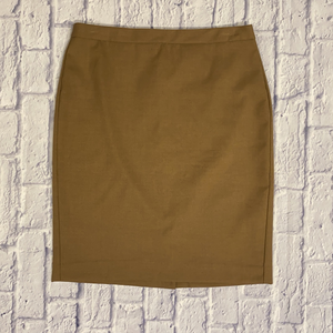 Perfect Banana Republic fitted knee length skirt in tan with slight slit in back.