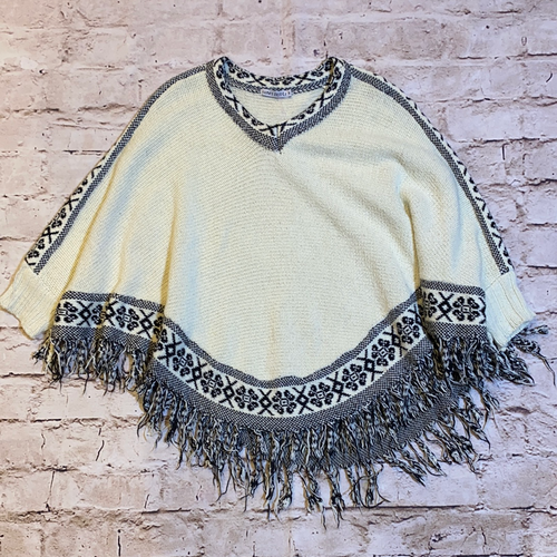 Funky People black and cream poncho with fringe bottom and neckline, sleeve, and hem geometric pattern.