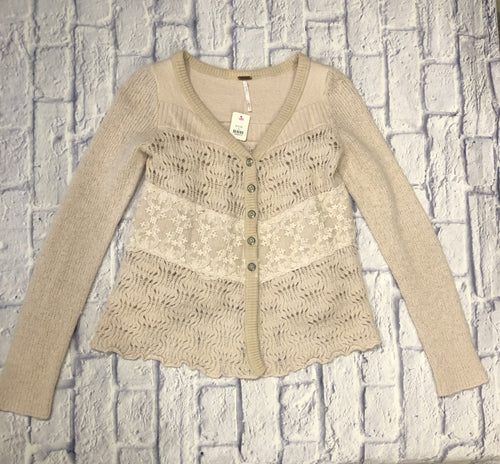 Free People blush pink cardigan with crochet top/bottom and lace strip in the middle.  Button up.  Back is crochet as well.  V neckline.