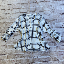 Load image into Gallery viewer, Collective Concepts black and white large pattern plaid blouse with button sleeve detail.