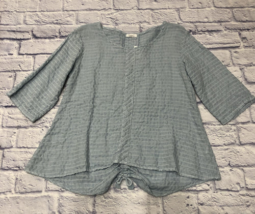Beautiful light blue linen waffle blouse by Linnea.  3/4 sleeve with gathered cinch back detail and front collar accent.