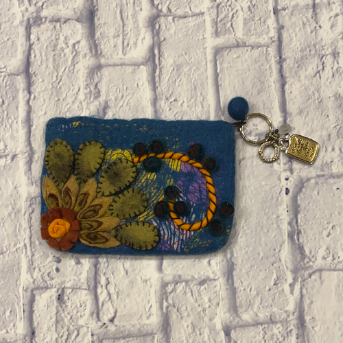 Rising Tide wool blue clutch with green floral pattern and turquoise lining.