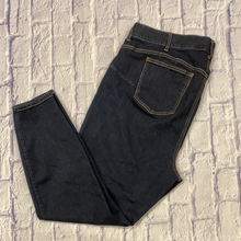 Load image into Gallery viewer, Torrid bombshell blue skinny dark wash jeans with tan stitching detail.