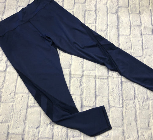 Lildy blue active leggings with mesh insets on the legs, zipper pocket in the waist band.