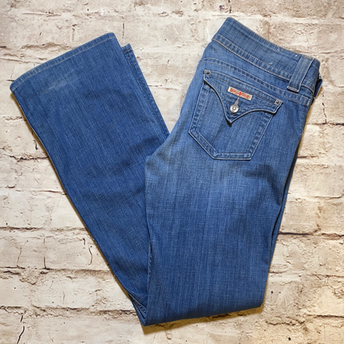 Hudson medium wash wide leg jeans with flap back pockets.
