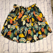 Load image into Gallery viewer, Lularoe Madison skirt in navy with orange, yellow, and teal floral pattern.  Pockets!  Wide elastic waist bad, good stretch.  Midi length.  New with tags.