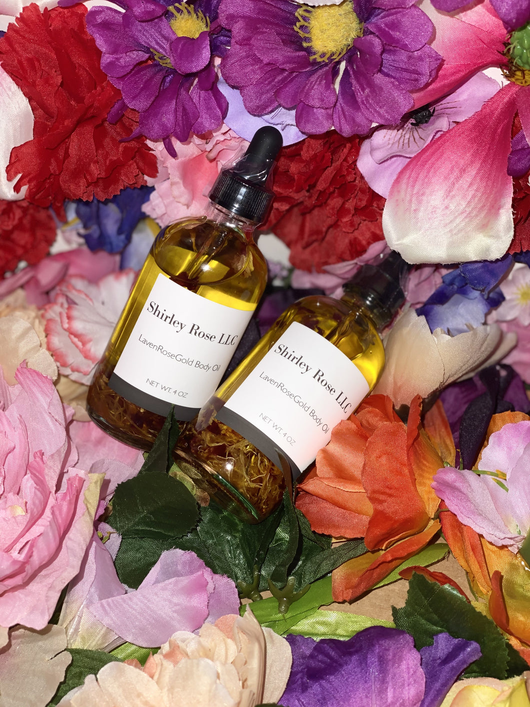 Two 4 oz bottles filled with nourishing oils to soothe the body.