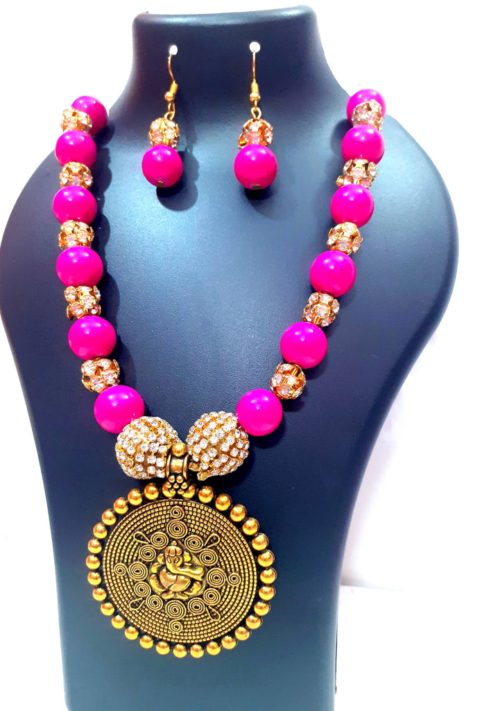 Beads N Threads - Beautiful Pink Necklace with big Golden Oxidized pendant and Earrings.