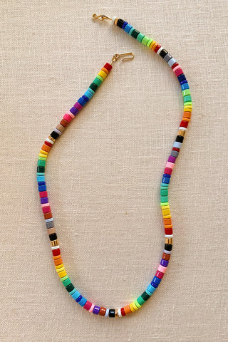 How to DIY an enamel rainbow beaded necklace.
