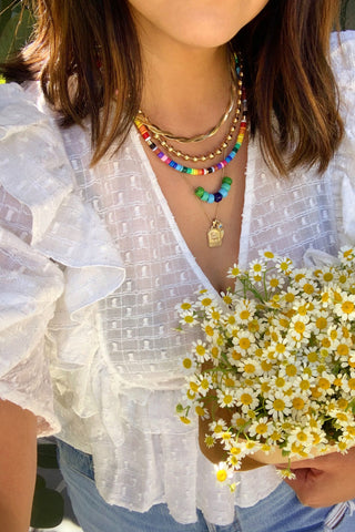 Erica Chan Coffman styling her rainbow Enamel Beaded necklace, made using kit from WomanShopsWorld
