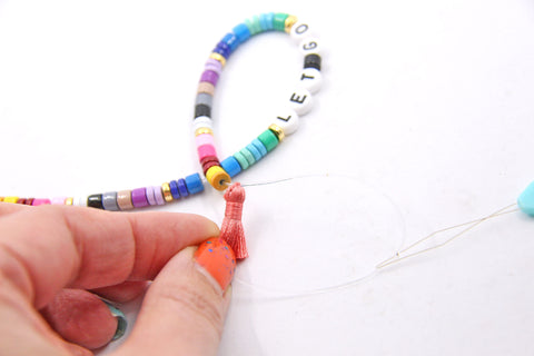 How to make a beaded tassel bracelet with enamel disc beads, by WomanShopsWorld