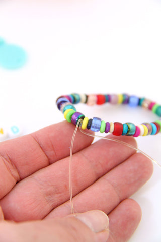 How to tie a Square Knot on an elastic beaded bracelet