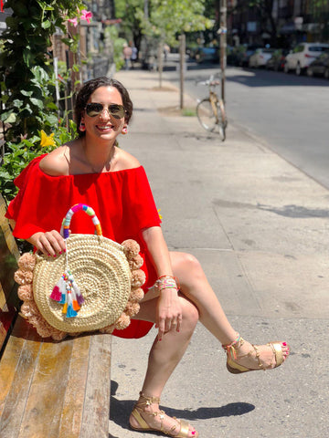 Marisa from The Neon Tea Party with her DIY Tassel and Raffia Pom Pom Straw Bag