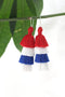 Red, White, and Blue Tiered Tassel Earrings - ShopWomanShopsWorld.com. Bone Beads, Tassels, Pom Poms, African Beads.
