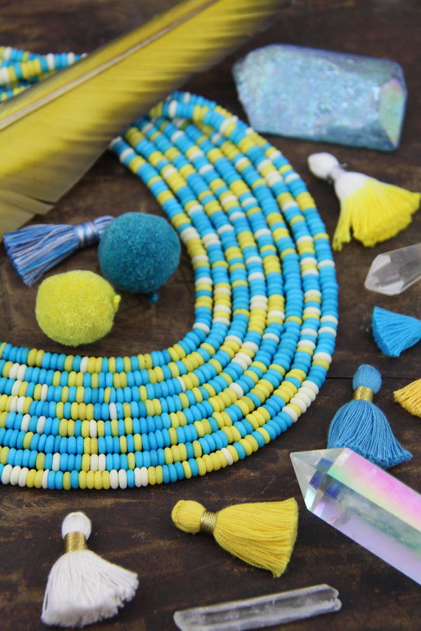 Icy Lemon : Aqua, White, Yellow, Bone Beads, 5x2mm - ShopWomanShopsWorld.com. Bone Beads, Tassels, Pom Poms, African Beads.