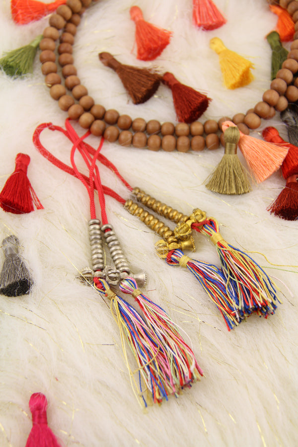 Count Your Mantras: Rainbow Tasseled Mala Counters, 2 Pieces - ShopWomanShopsWorld.com. Bone Beads, Tassels, Pom Poms, African Beads.