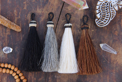 "Natural Horse Hair Tassels, 4.5"" - ShopWomanShopsWorld.com. Bone Beads, Tassels, Pom Poms, African Beads."