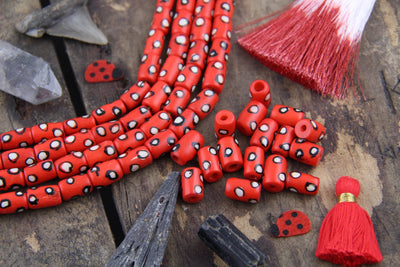 White Dotted Tubes: Hand Painted Red Bone Beads, 7x13mm, 16 pieces - ShopWomanShopsWorld.com. Bone Beads, Tassels, Pom Poms, African Beads.