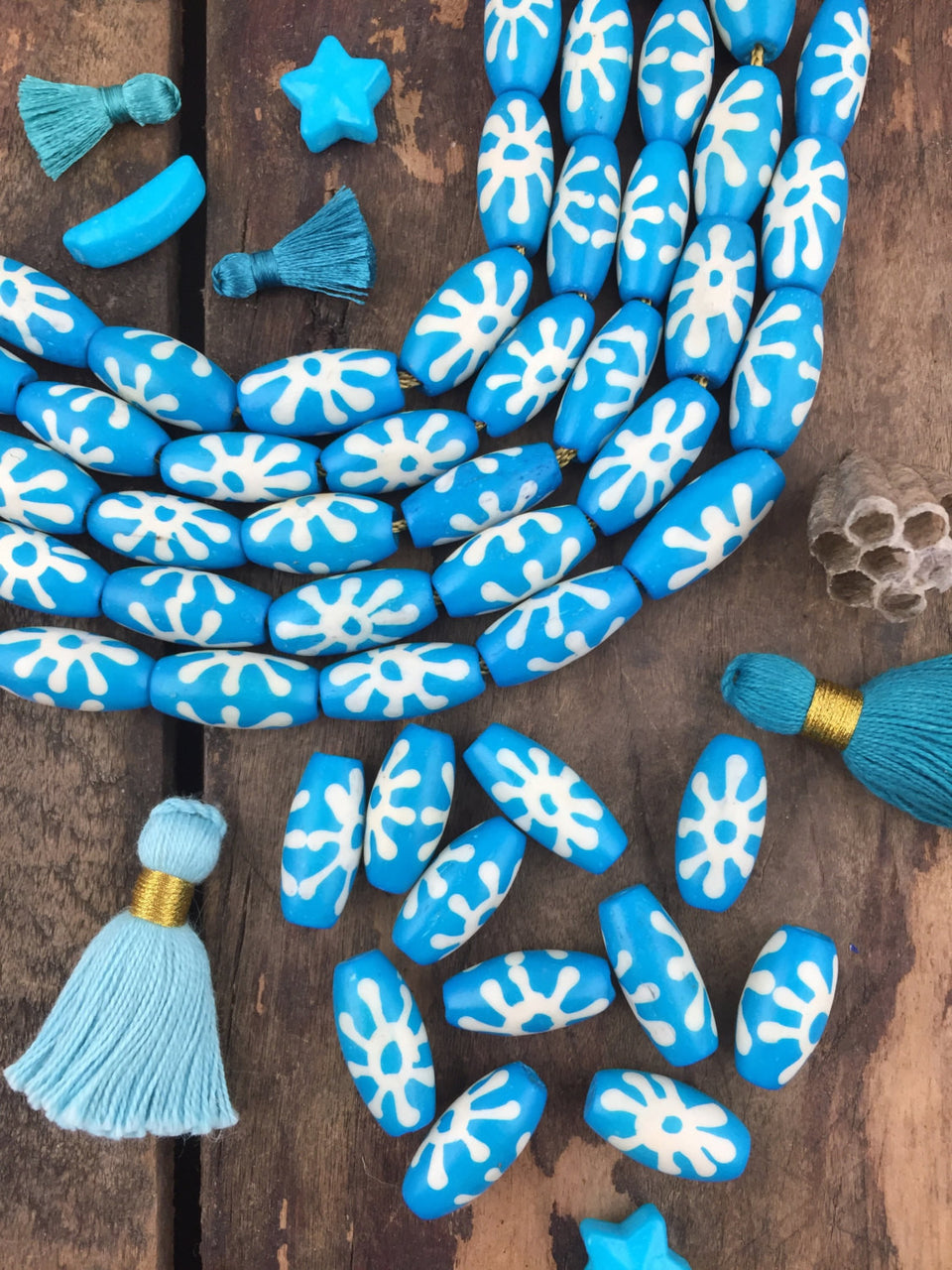 Turquoise Sunburst: Hand Painted Bone Beads, 10x17mm, 11 pieces - ShopWomanShopsWorld.com. Bone Beads, Tassels, Pom Poms, African Beads.