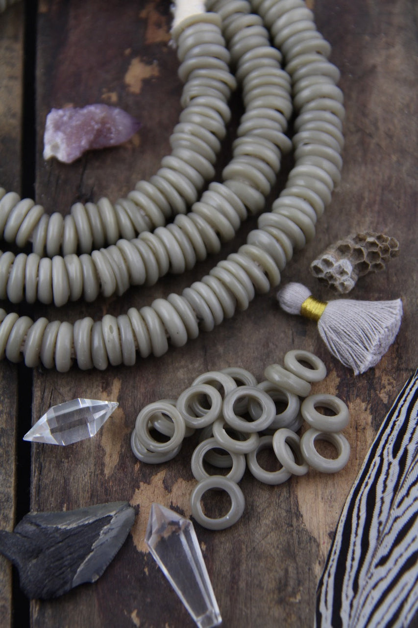 Grey Dutch Donut Dogan Beads, 11-12mm, 10 pieces - ShopWomanShopsWorld.com. Bone Beads, Tassels, Pom Poms, African Beads.