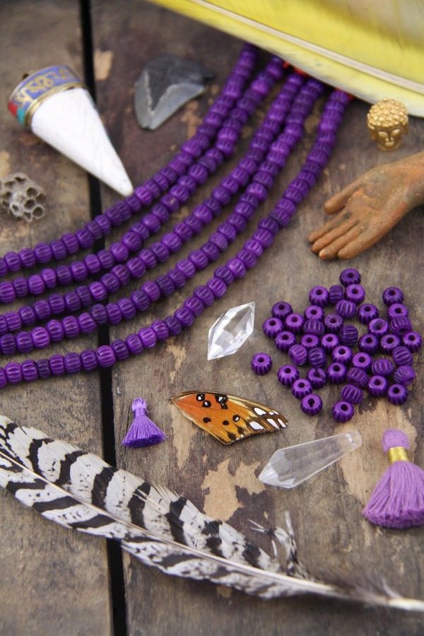 Purple Grooved Melon: Hand Carved Bone Beads, 4x7mm, 40 pieces - ShopWomanShopsWorld.com. Bone Beads, Tassels, Pom Poms, African Beads.