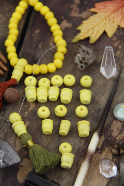 Yellow Bone Guru Beads, 8mm, 3 sets (6 beads) - ShopWomanShopsWorld.com. Bone Beads, Tassels, Pom Poms, African Beads.