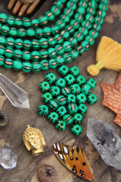 Golden Watermelon: Painted Green, Black & Gold Bone Beads, 6x8mm, 31 pieces - ShopWomanShopsWorld.com. Bone Beads, Tassels, Pom Poms, African Beads.