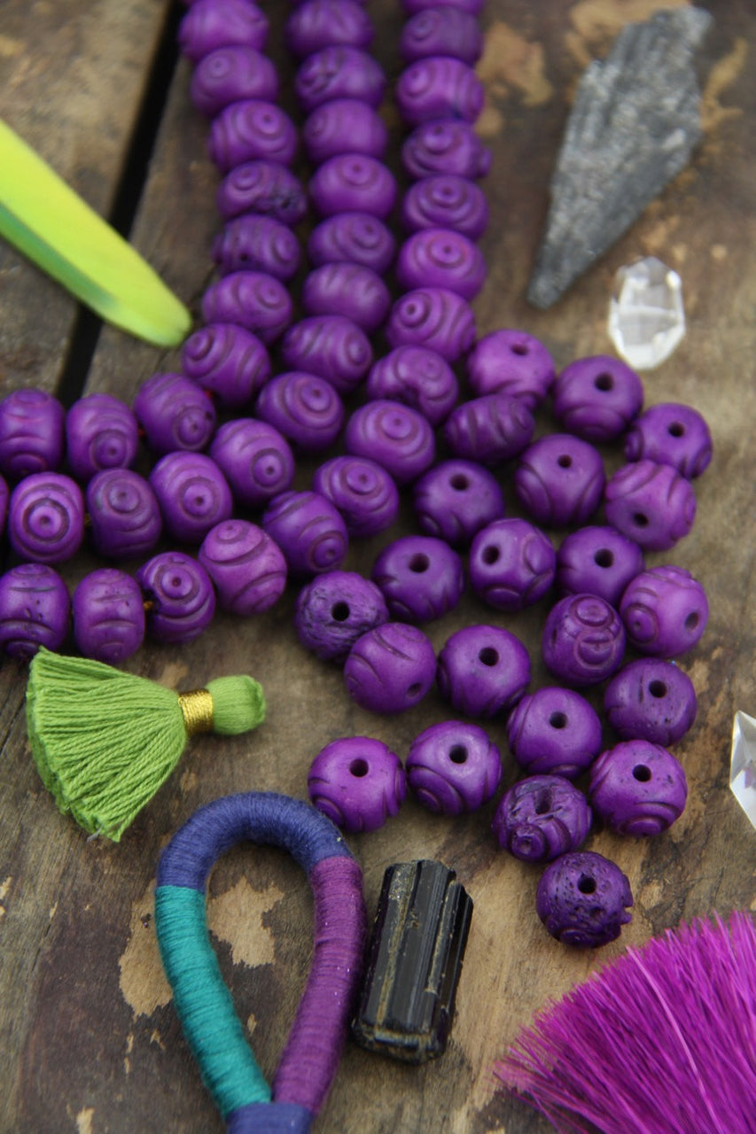 Purple Tribal Bullseye: Handmade Bone Beads, 10x14mm, 20 pieces - ShopWomanShopsWorld.com. Bone Beads, Tassels, Pom Poms, African Beads.