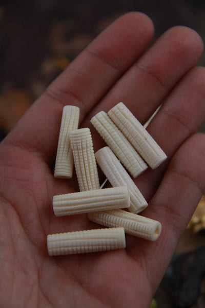 Crosshatch Tube: White Hand-Carved Bone Beads, 7x25mm, 8 pieces - ShopWomanShopsWorld.com. Bone Beads, Tassels, Pom Poms, African Beads.