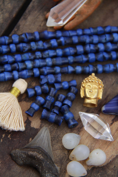 Indigo Hour Glass Barrel: Hand Carved Bone Beads, 6x14mm, 15 pieces - ShopWomanShopsWorld.com. Bone Beads, Tassels, Pom Poms, African Beads.
