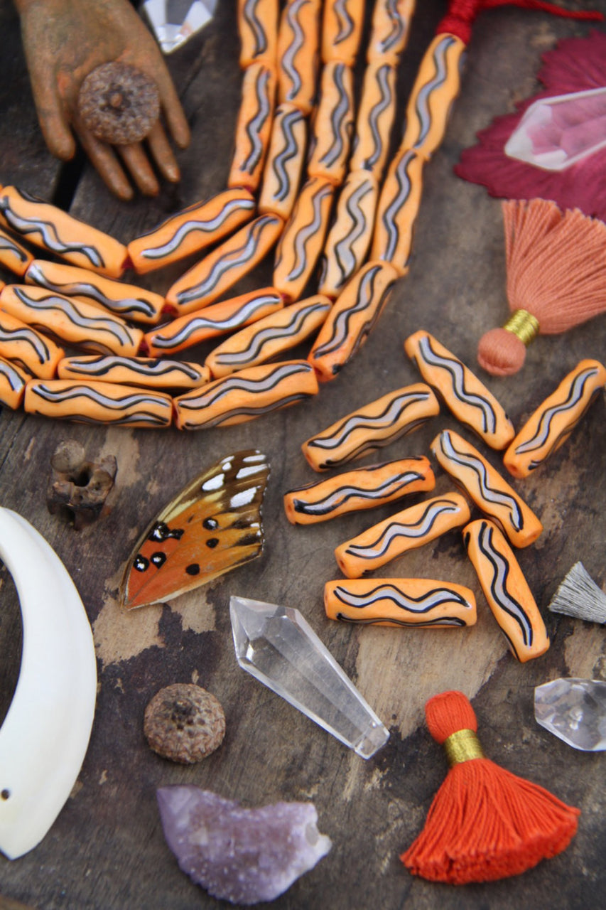 Orange Squiggle Barrel: Hand Painted Bone Beads, 7x27mm, 8 pieces - ShopWomanShopsWorld.com. Bone Beads, Tassels, Pom Poms, African Beads.