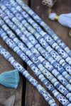 Denim Airy Blue Tribal Target Tube: Carved Bone Beads, 7x25mm, 9 pieces - ShopWomanShopsWorld.com. Bone Beads, Tassels, Pom Poms, African Beads.